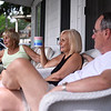 Darlene Johnson, left, sits with Deborah and Bill Doan on their North Lake Drive porch on Friday, June 16, 2017. OLIVIA SUN/STAFF PHOTOGRAPHER