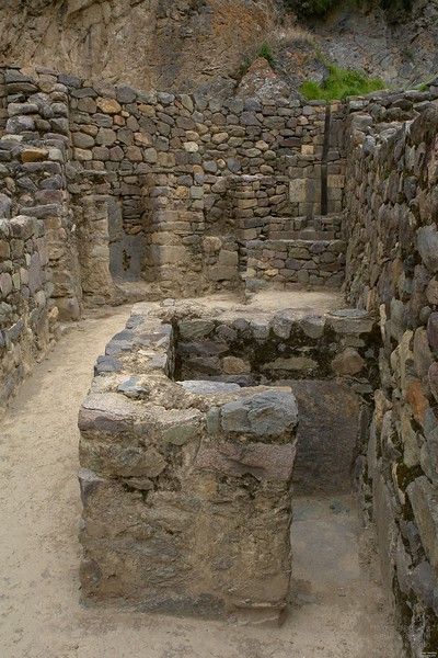 These bathroom facilities are located inside the house which is quite unusual for a time 700 years ago. Water basins in the back with water conduit in the natural rock above and subterranean outflows. The small room in front might have been a toilet.