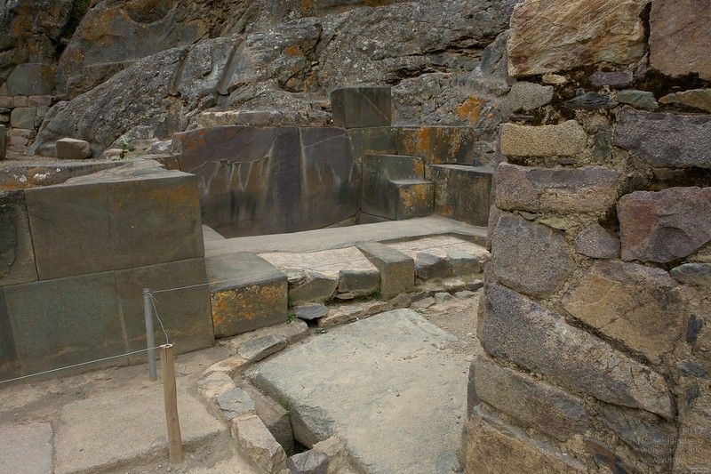 Bathrooms with water conduit in the natural rock above and outflow in the floor.