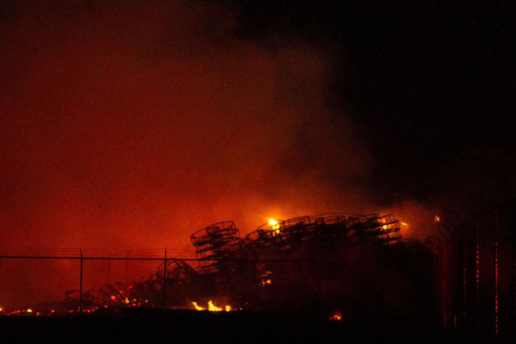 . Crab pots burn on Olsen Dock in Fields Landing on Tuesday night. Hundreds of crab pots were burned, Humboldt Bay Fire reported. (Thomas Lal - Contributed)