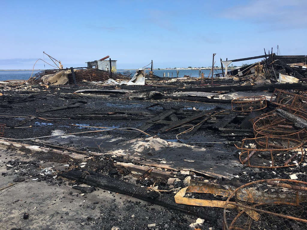 . The burned remains of Olsen Dock in Field Landing was seen Wednesday. An assessment of the damage is still pending, Humboldt Bay Fire said. (Shaun Walker - The Times-Standard)