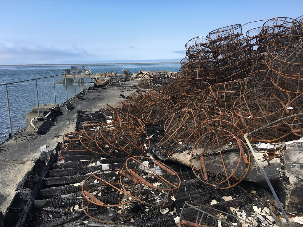 . Burned crab pots sit in a burned pile Wednesday in Fields Landing. (Shaun Walker - The Times-Standard)