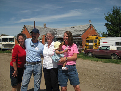 Louise Christianson, Arthur Jensven, Becky, Aileen Keifer with Esther in front of their old home!