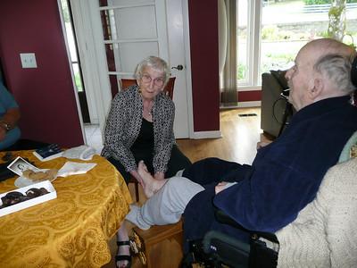 Norma giving Jimmy a foot rub followed by a shoulder rub.  He said it felt good.