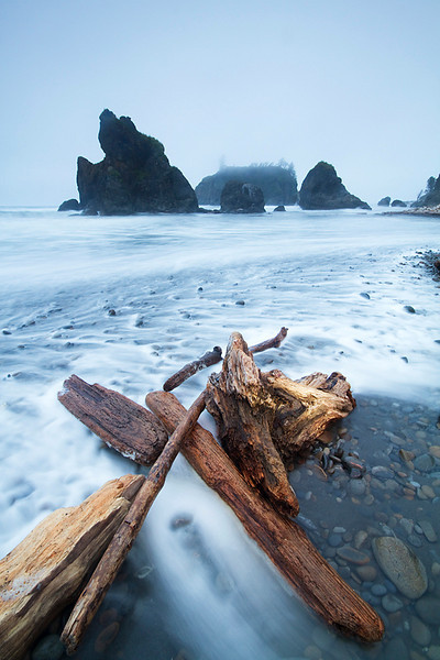 Driftwood in the rushing waves on Ruby Beach.