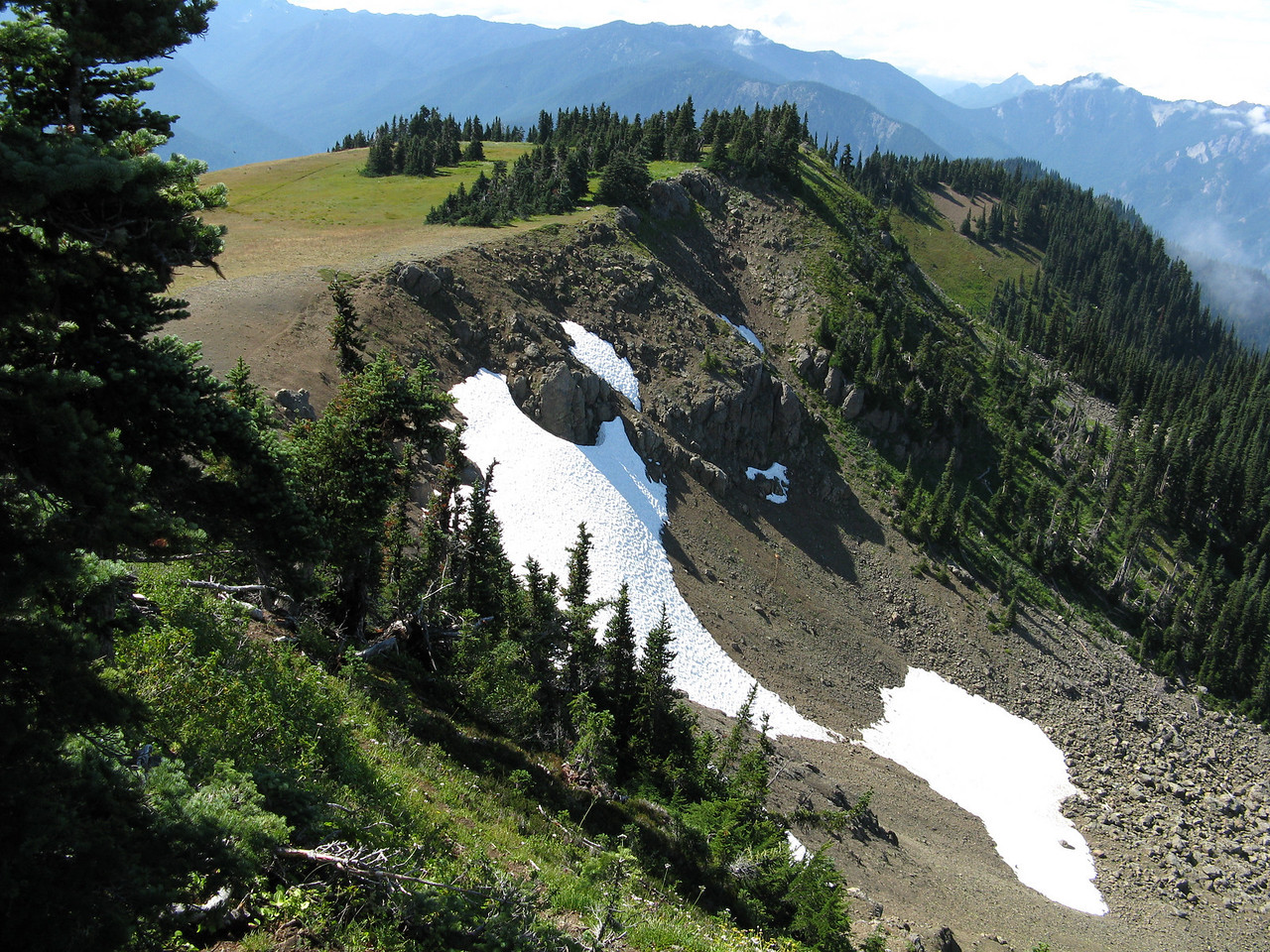 The north-facing slope still has snow fields.