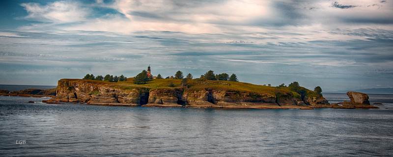 Cape Flattery Lighthouse (inactive) on Tatoosh Island, viewed from Cape Flattery.