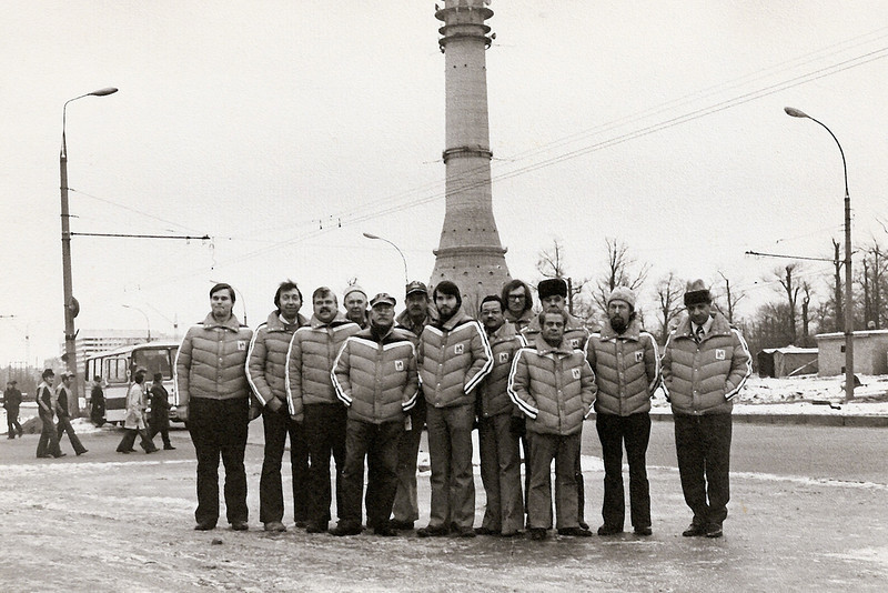 NBC technical construction crew for 1980 Moscow Summer Olympics. Photo taken Fall, 1979.<br /> We are standing in front of the Ostankino TV tower in Moscow. <br /> L-R: Ray Fritzky, Steve Seidenfrau, Stan Bryer, Gene Ward, Fred Favant, John Frishette, Tim Dwight, Juan Ortiz, John Pachuta, Dave Turley (behind), Dave Crosby (front), Darryl Grisset, Ralph Yanny.