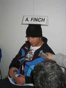 First time Olympian Andy Finch hams it up with the media at the arrival press conference