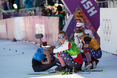 Jessie Diggins, Sadie Bjornson, Liz Stephen and Kikkan Randall after the finish of the 4x5 team relay 2014 Olympic Winter Games - Sochi, Russia. Women's Cross Country 4x5 Team Relay  Photo: Sarah Brunson/U.S. Ski Team