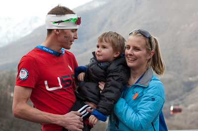 Billy Demong with his son and wife. 2014 Olympic Winter Games - Sochi, Russia. Nordic Combined Team event Photo: Sarah Brunson/U.S. Ski Team
