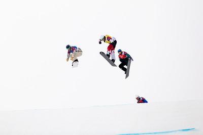 Alex Diebold, USA (blue bib), Kevin Hill, CA (yellow bib), Alex Pullin, AUS, (red bib) 2014 Olympic Winter Games - Sochi, Russia. Men's Snowboardcross Photo: Sarah Brunson/U.S. Snowboarding