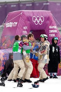 Alex Diebold and teammates celebrate Alex's bronze medal finish 2014 Olympic Winter Games - Sochi, Russia. Men's Snowboardcross Photo: Sarah Brunson/U.S. Snowboarding