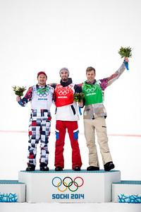 Silver medalist, Nikolay Olyunin, RUS, gold medalist, Pierre Vaultier, FRA, bronze medalist, Alex Diebold, USA 2014 Olympic Winter Games - Sochi, Russia. Men's Snowboardcross Photo: Sarah Brunson/U.S. Snowboarding