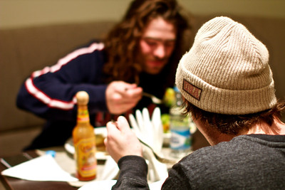 Danny Davis (l) and Greg Bretz (r) Athletes eating dinner at the Team hotel. Food prepared by USSA Chef Allen Tran. Photo: Kyle Kilcomons/USSA
