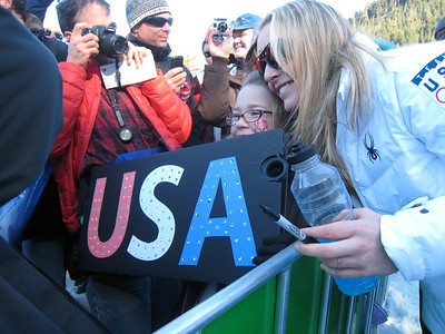 Lindsey Vonn with a fan holding a USA sign that lights up (Doug Haney/U.S. Ski Team)