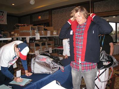 Steven Nyman tying on the new Olympic Polo wear (Doug Haney/U.S. Ski Team)