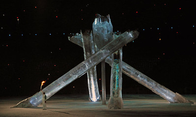 The Olympic cauldron is lighted by a torch as fans pack BC Place for the Closing Ceremony of the 2010 Vancouver Olympic Winter Games. (Tom Kelly)