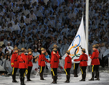 Royal Canadian Mounted Police color guard raises the Olympic flag at the Closing Ceremony of the 2010 Vancouver Olympic Winter Games. (Tom Kelly)