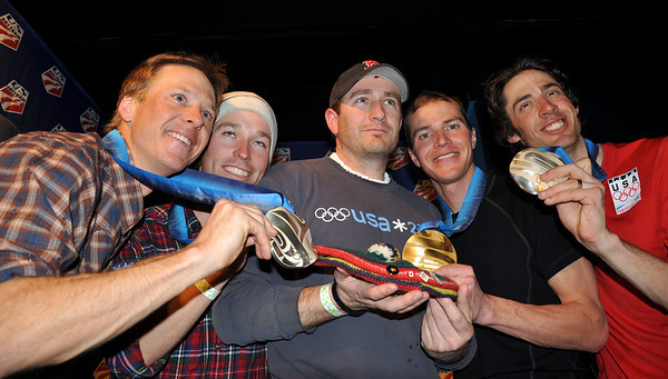 Memories of friend Paul Robbins as the silver medal nordic combined team of Todd Lodwick, Brett Camerota, Billy Demong and Johnny Spillane surround Paul Robbins' son DC Robbins and Paul's familiar Scottish Tam. (U.S. Ski Team/Katie Perhai)