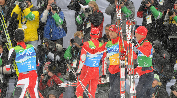 Johnny Spillane and Todd Lodwick congratulate the gold medal Austrians after winning a silver medal for Team USA at Olympic Nordic Combined Team event. (U.S. Ski Team/Tom Kelly)