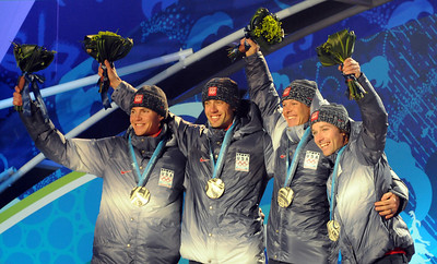 The U.S. Ski Team's silver medalists celebrate including (from left) Billy Demong, Johnny Spillane, Todd Lodwick and Brett Camerota at the medals ceremony for the Olympic Nordic Combined Team event. (U.S. Ski Team/Tom Kelly)