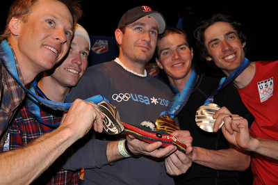 Brett Camerota, Billy Demong, Todd Lodwick and Johnny Spillane, Nordic Combined team event silver medalists with DC Robbins holding his father, Paul Robbin's, tam Spyder U.S. Ski Team House, Whistler, BC 2010 Olympic Winter Games  Photo: Katie Perhai/USSA