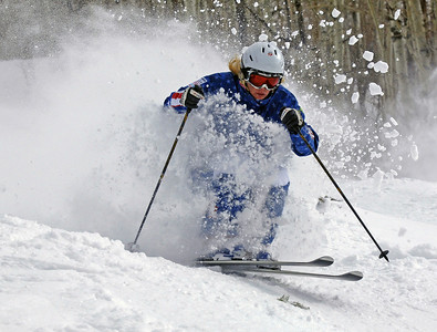 Olympian Michelle Roark skis through a powder-filled moguls course in the pre-Olympic moguls training camp on Voo Doo in Steamboat Springs, Colorado. Photo: Steamboat