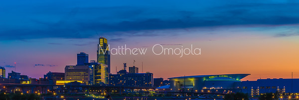 Blue hour sunset over downtown Omaha. The tallest building is the First National Bank of Omaha headquarters. The Convention Center is to the right. Beautiful skyline. Editorial photo.