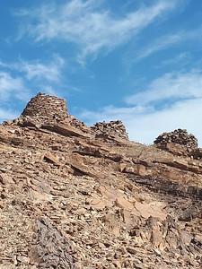 Looking up at the tombs at Al Ayn.
