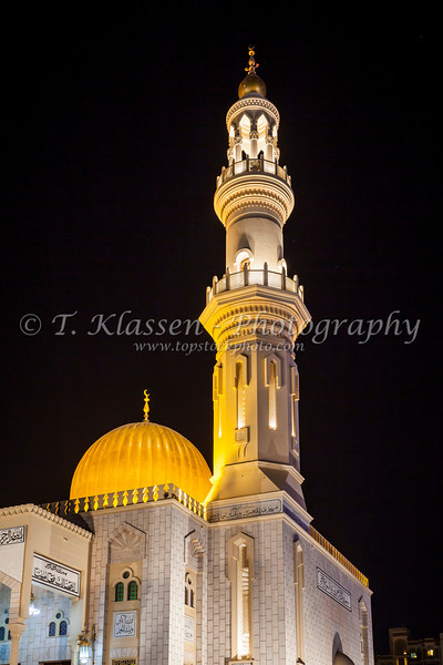 The Al Zawawi Mosque illuminated at night in the city of Muscat, Oman.