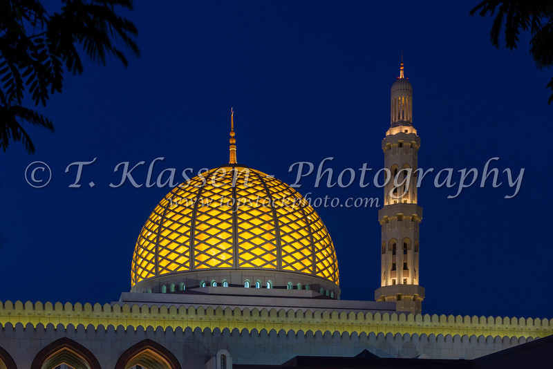 The Grand Mosque illuminated at night in Muscat, Oman.