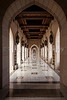 Arched hallways of the Grand Mosque in Muscat, Oman.