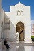 A muslim woman talking on a cell phone outside the Grand Mosque in Muscat, Oman.
