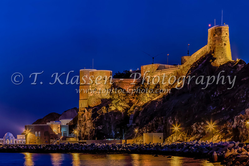 The Al Mirani fort illuminated at night in Muscat, Oman.