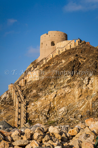 A small Portuguese lookout tower overlooking the harbor in Muscat, Oman.