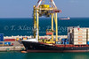 Loading a container ship in the port city of Muscat Oman.