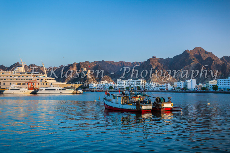 Boats anchored in the harbor of Muscat, Oman.