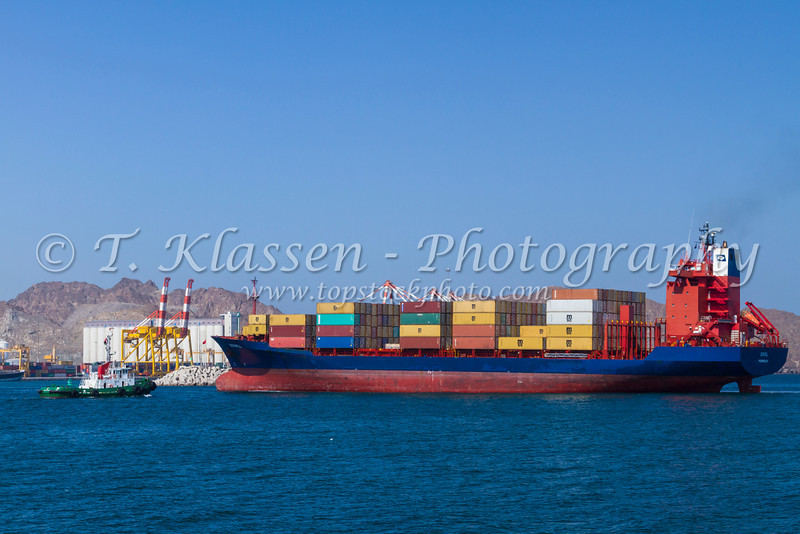 A container ship entering Port Sultan Qaboos in Muscat, Oman.