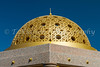 The gold dome of a waterfront shelter on the promenade in Muscat, Sultanate of Oman.