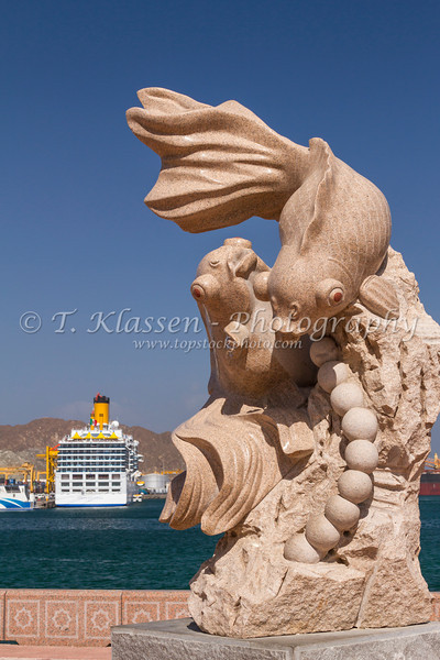 An artistic fish sculpture on the harbourfront promenade in Muscat, Oman.