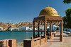 A gold dome cupola shelter on the Corniche promenade in Muscat, Oman.