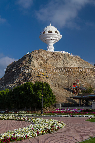 An incense burner landmark on a hilltop overlooking Muscat, Oman.
