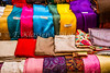 Closeup of textiles, scarves and shawls for sale at the Muttrah souq market in Muscat, Oman.