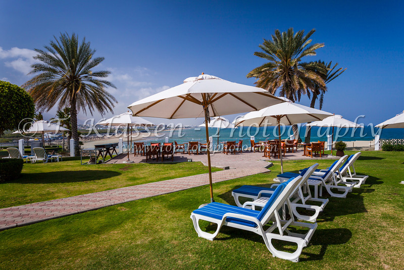 An outdoor seaside patio at the Crowne Plaza Hotel in Muscat, Oman.