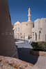The Nizwa historic fort and mosque minaret in Nizwa, Sultanate of Oman.