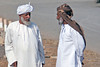 Two men have a discussion in the Barka Village in Oman.