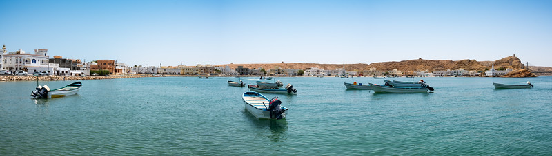 A panoramic view of the fishing boats on the sea in the harbour of Ayjah, a suburb of the port of Sur, Oman.