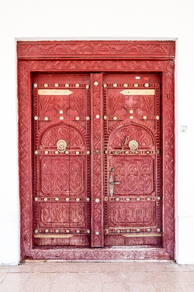 A traditional Arabian eleborately carved entrance door to a house.