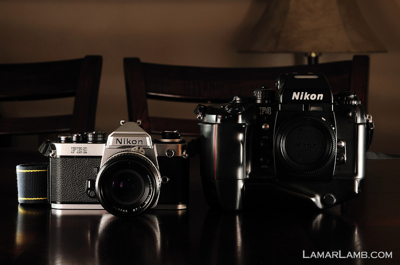 A Nikon FE2 next to the Nikon F4s.  The size difference is huge as is the difference in weight.